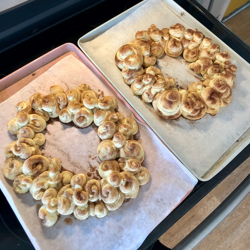 Challah wreaths made of challah bread with cinnamon and sugar topping