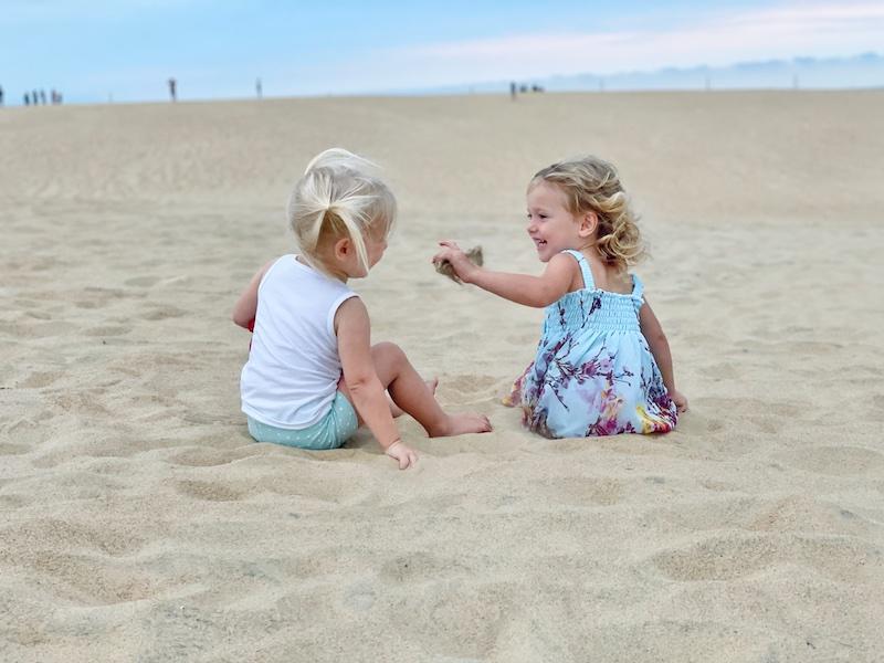 Toddler girls at Jockey's Ridge State Park in Outer Banks North Carolina