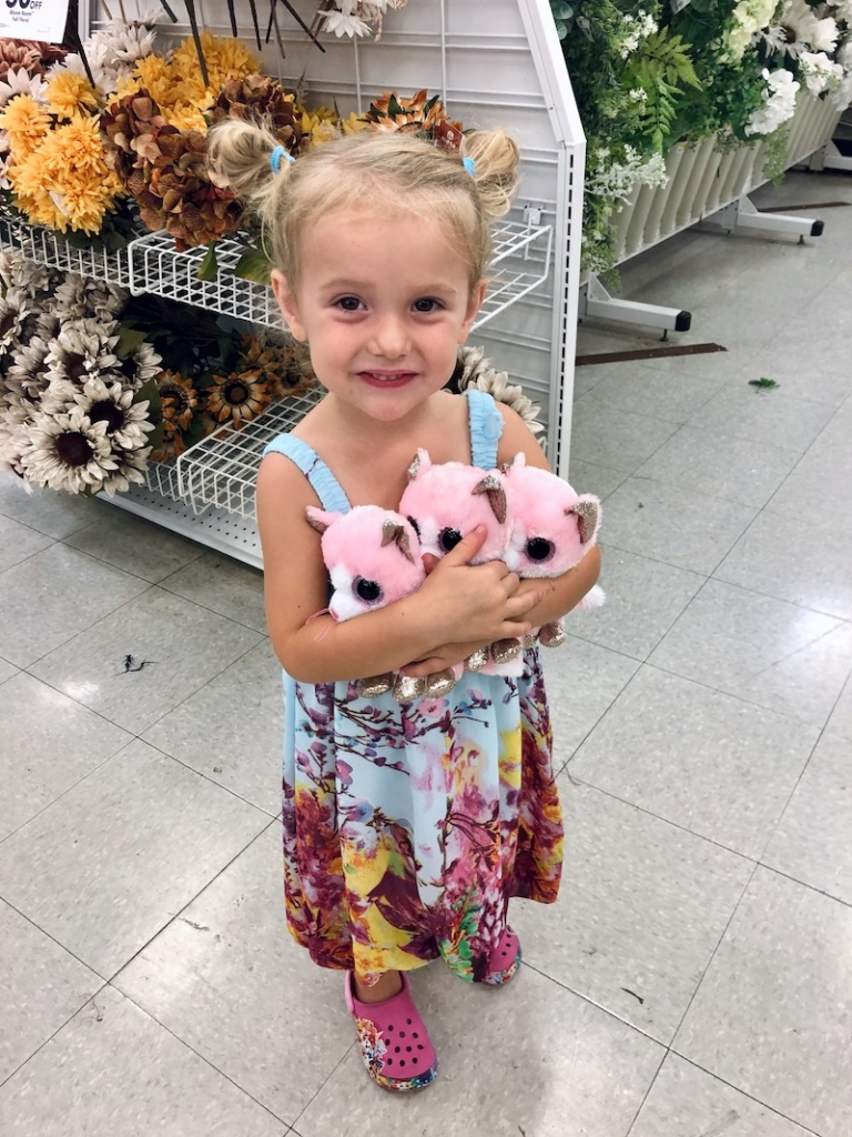 Toddler holding TY beanie boos