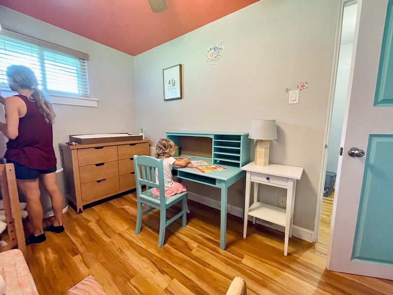 Toddler homeschool room and bedroom with blue desk