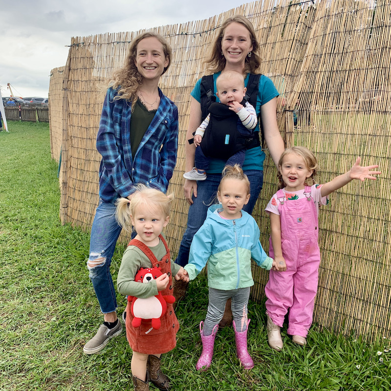 Girls with four kids at corn maze