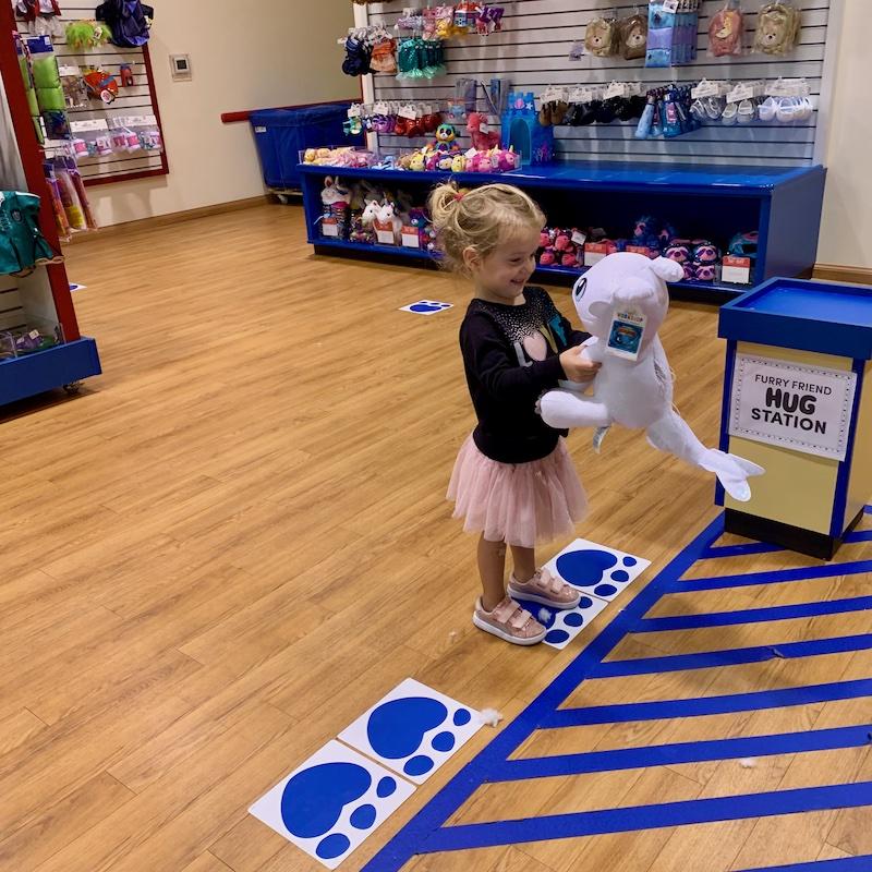 Toddler girl at Build a Bear
